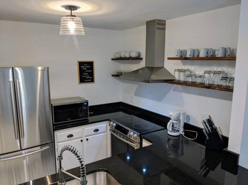Open kitchen with new Samsung appliances