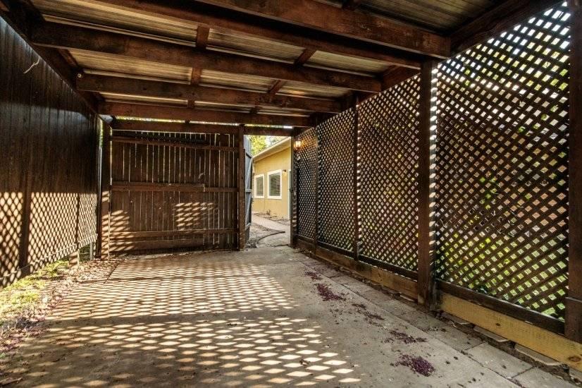 Entrance through gate with codelock deadbolt.