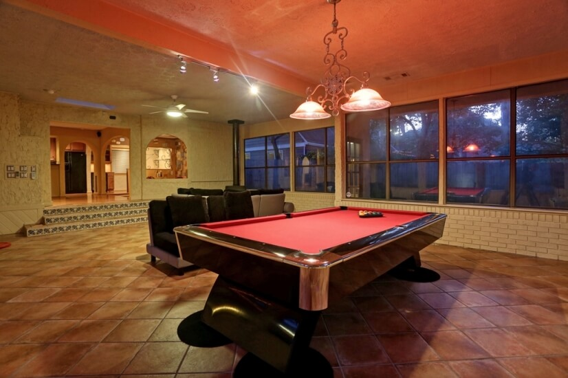 Great room, pool table, wood burning fire place pool view