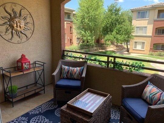 balcony overlooking green space courtyard