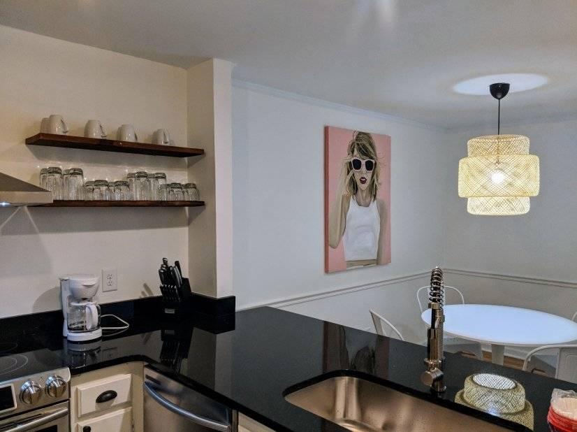 Open kitchen with original artwork