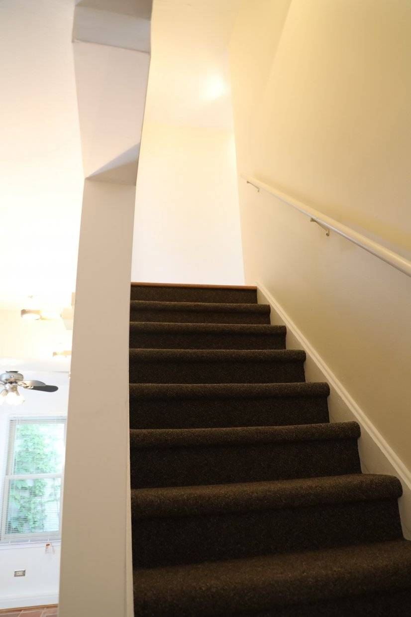 Stairway to upstairs [bedrooms].