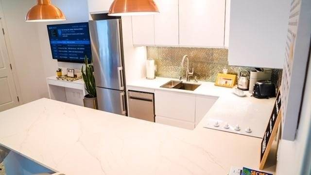 Your completely furnished kitchen & counter with 3 barstools