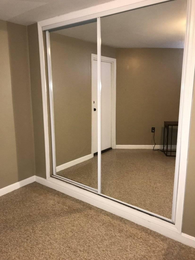 Mirrored walk in closet in bedroom.