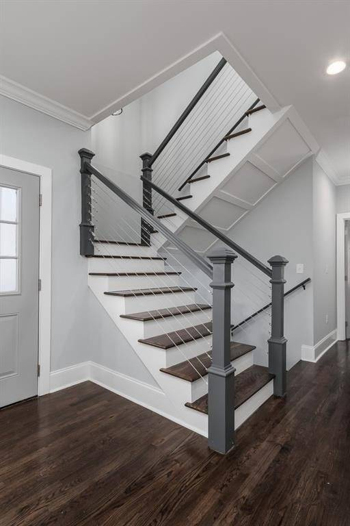 stairs are seen from the main area on second floor