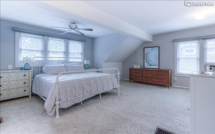 Carpeted, extra large upper master bedroom wi