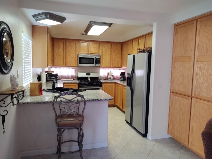Kitchen w/granite counters & pantry area