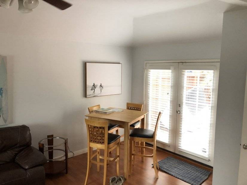 Dining area and access to back yard patio & outdoor kitchen