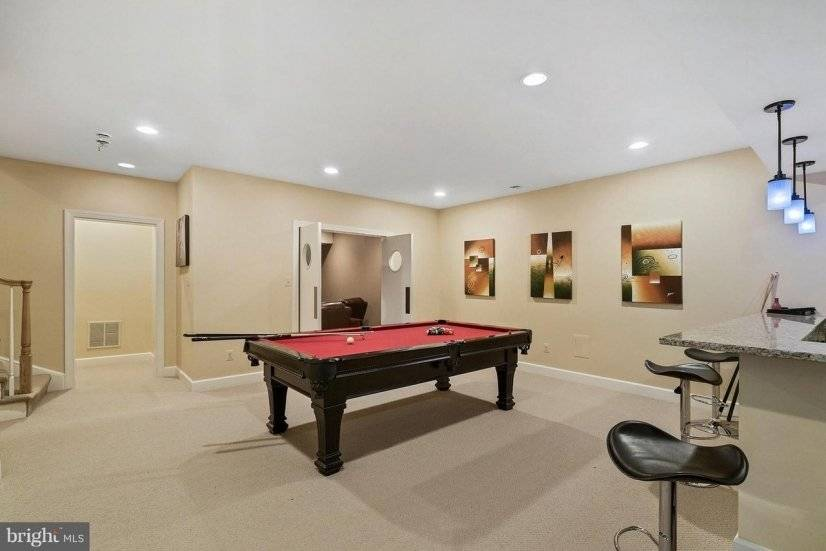 Basement game room also includes basketball and pac man