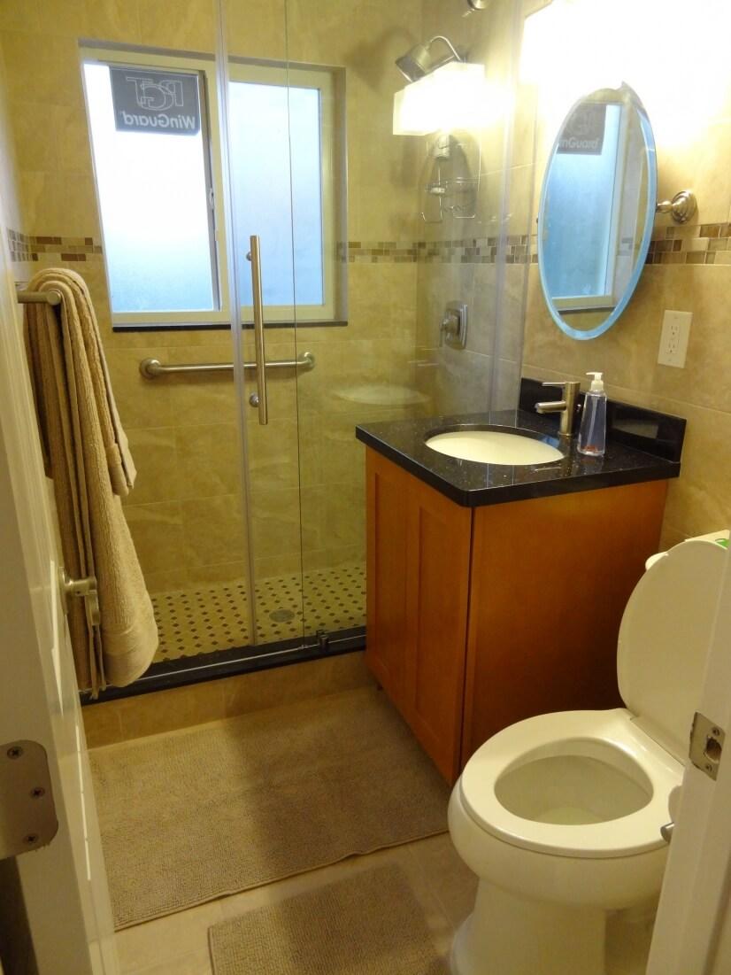 Modern bathroom with floor to ceiling tile.