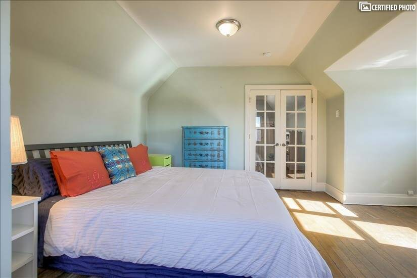 Upstairs - down comforter, windows with views of downtown