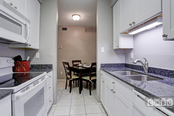 Kitchen has new appliances, granite counters.