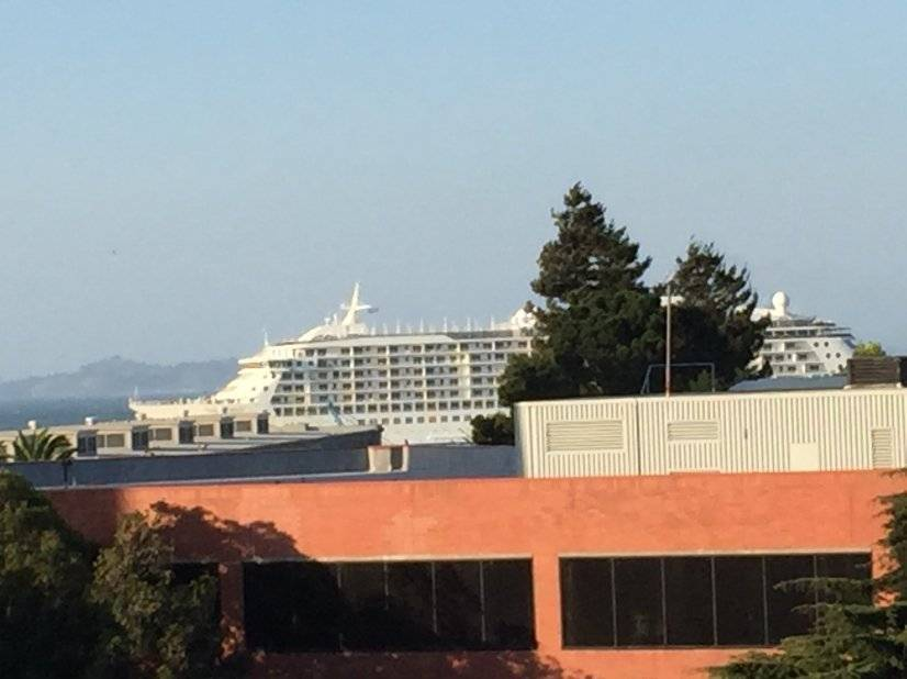 Cruise ships sail by headed for the Golden Gate