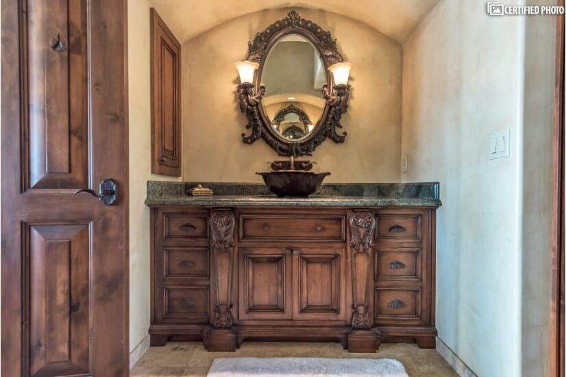 Hand carved vanities with bronze bowl sinks