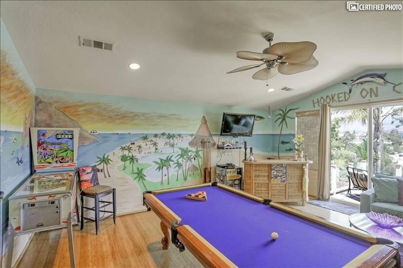 Pool table, bar area and pinball machine.
