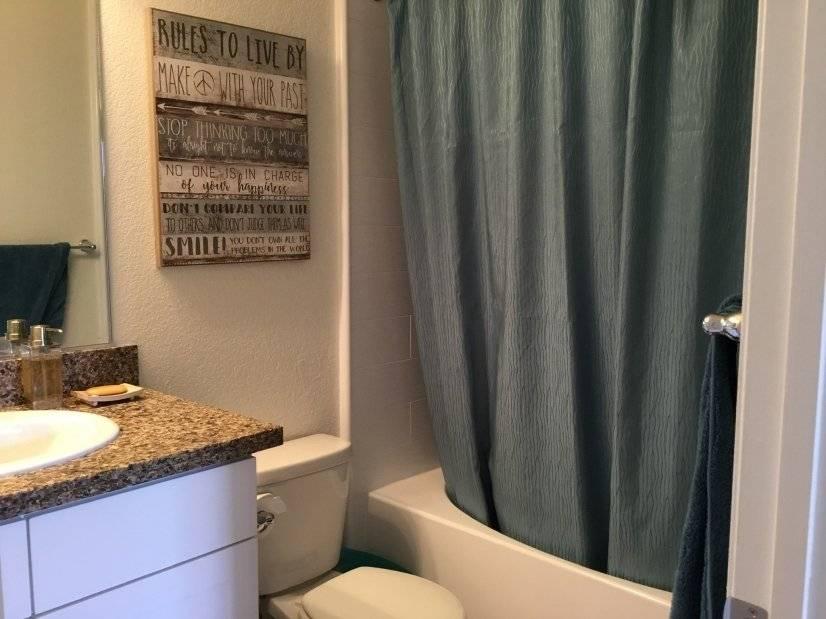 Double suite bathroom has Roman tub.