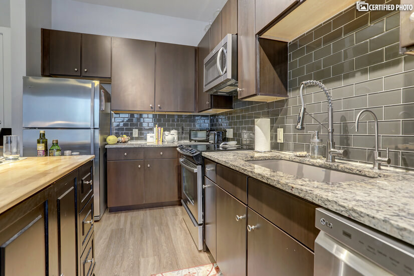 stainless steel appliances with single basin quartz sink