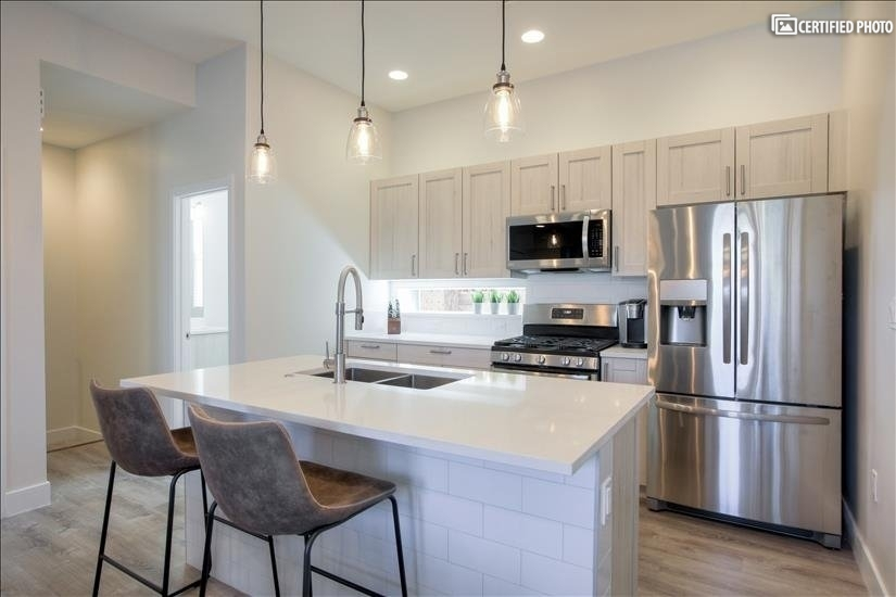 Stainless Steel appliances in spacious kitchen