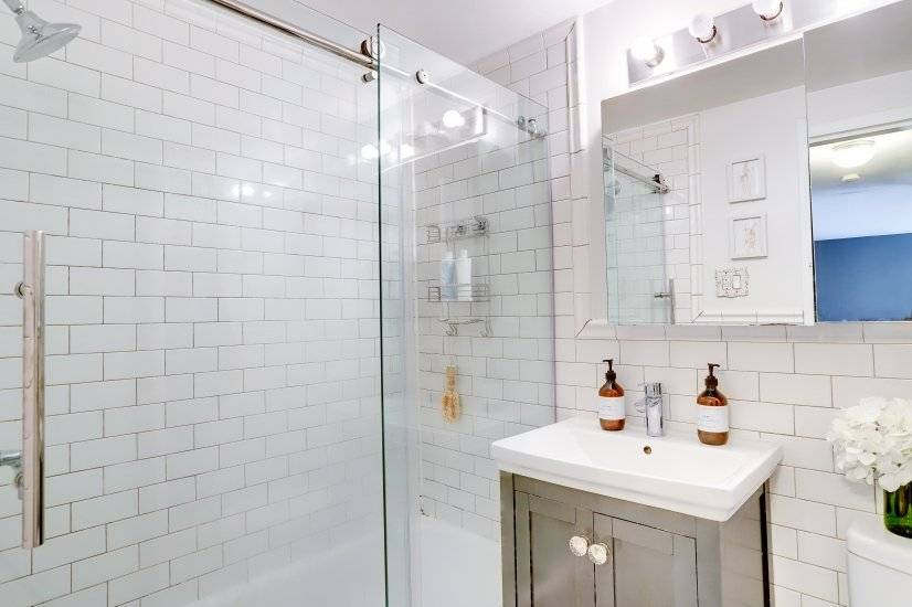 Large shower head and spacious bathroom