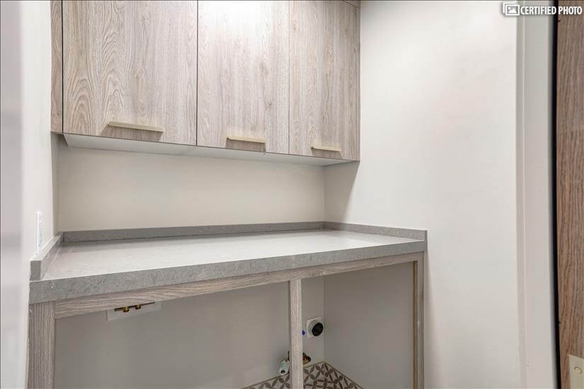 Laundry room, with Countertop and cabinet storage!