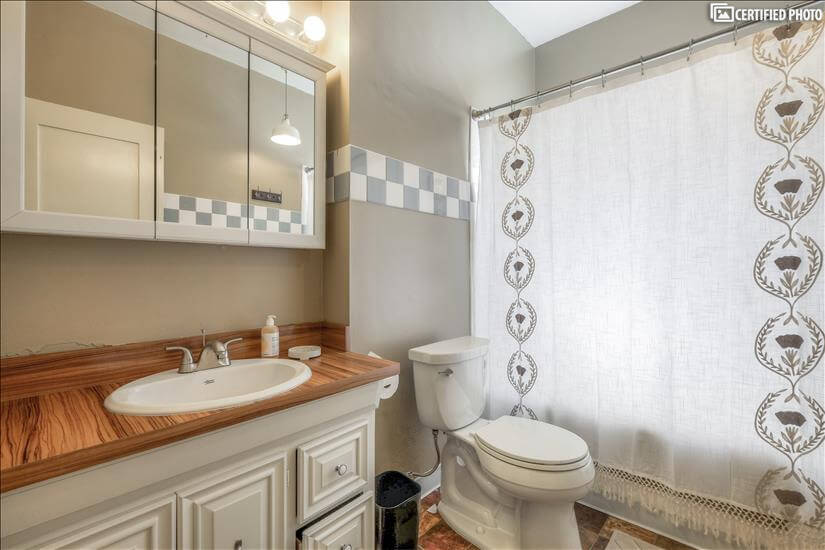 Combination bathtub and shower along with a large vanity spa