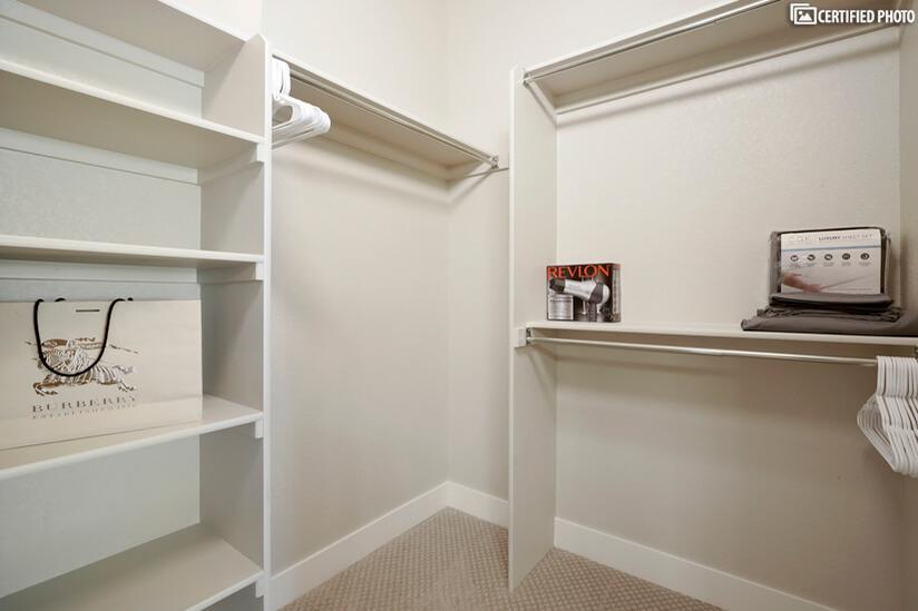 Luxurious walk-in closet in master suite