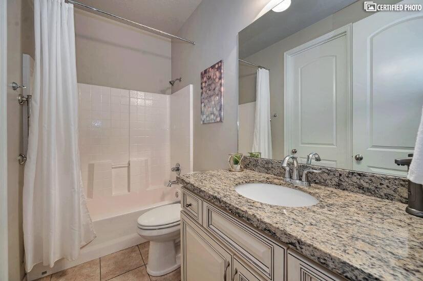 Main Floor On-Suite Bathroom with Shower & Tub