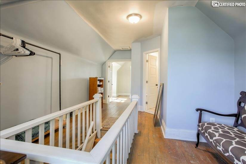 Upstairs - rolling closet and sitting area