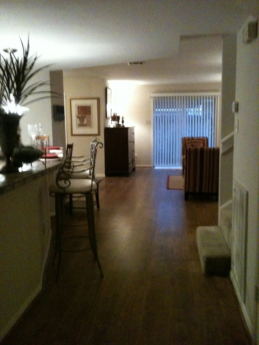 View of den from entry hall, sliding glass doors to patio