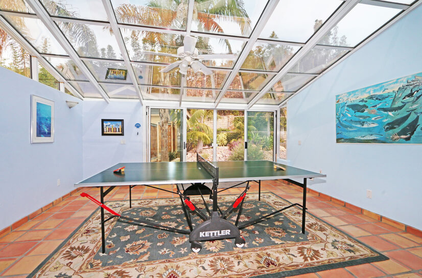 Downstairs sunroom/game room with ping pong
