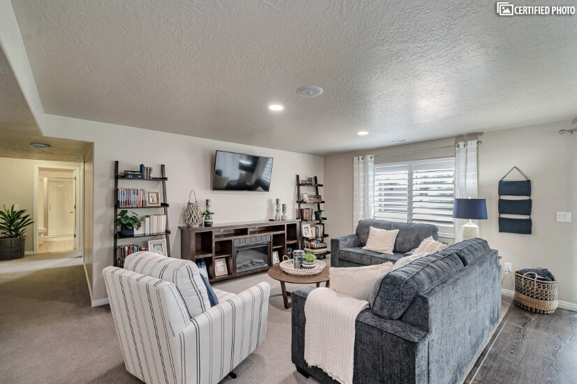 Downstairs Living Room with Electric Fireplace & Games