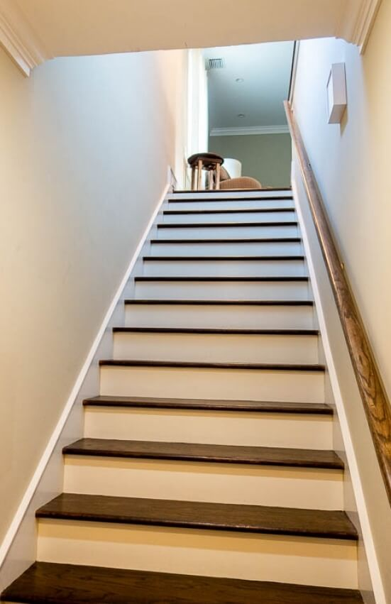 The stairs into the apartment are inside the front door.
