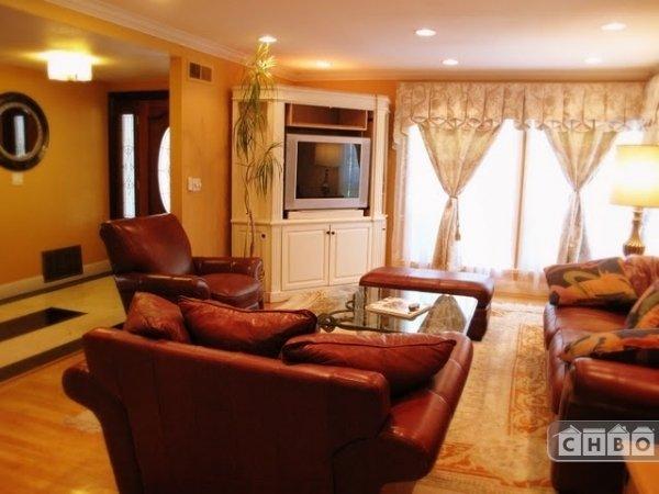 Living room with custom draperies & HDTV