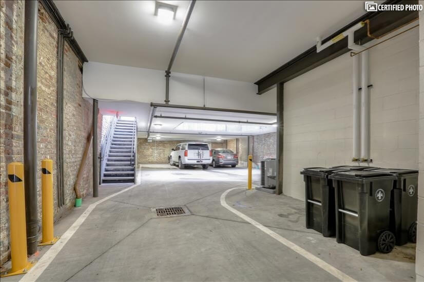 Private, gated parking garage on first floor of building
