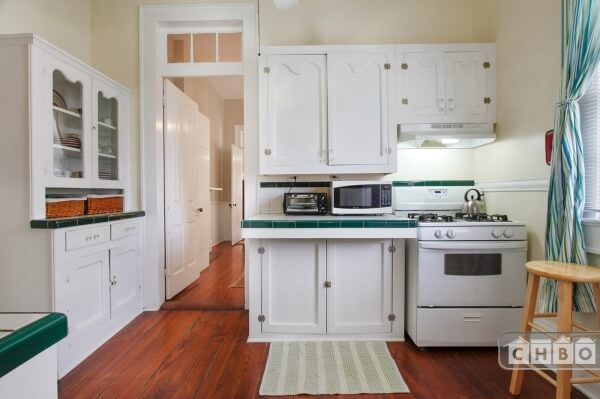 Kitchen with Original Built-In Cabinet, ample