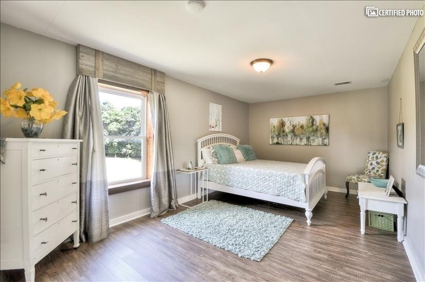 Bedroom 2 with closet and storage tastefully decorated