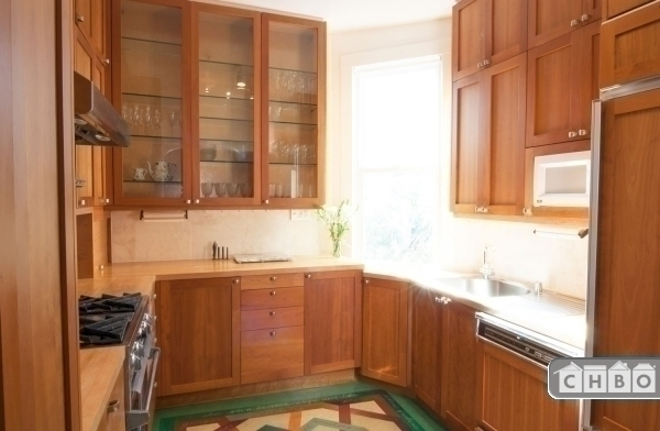 gorgeous custom kitchen has loads of cabinets and great appl