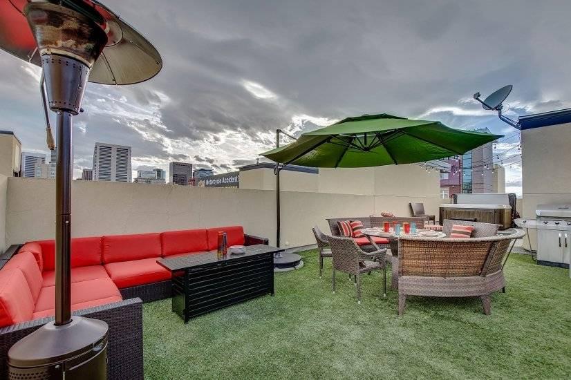 Maneuver the oversized umbrella to enjoy the shade.