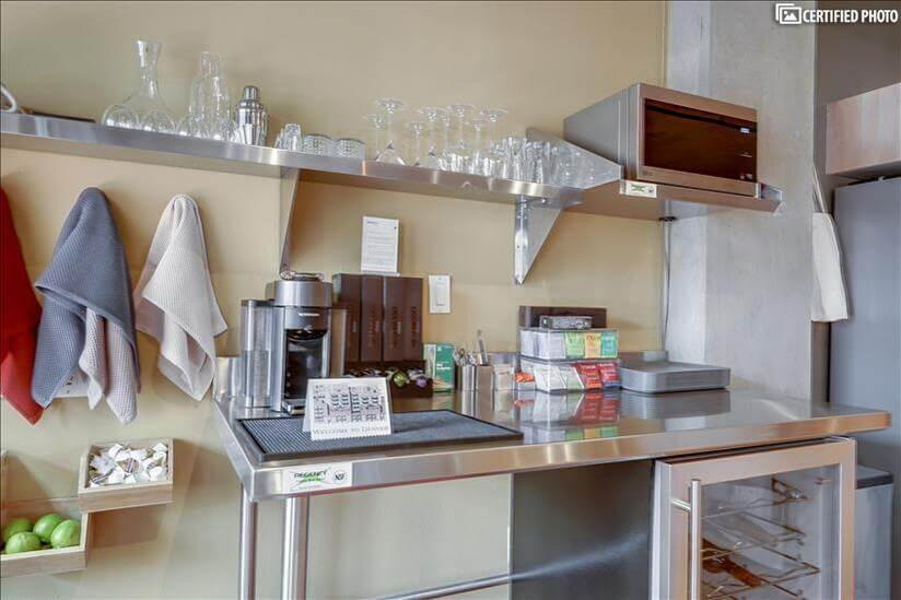 fully stocked stainless-steel coffee bar & Wine refrigerator