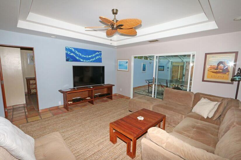 Family room off kitchen with 65 inch LG Smart