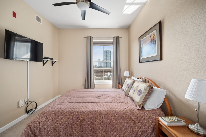 Master bedroom with a city view.