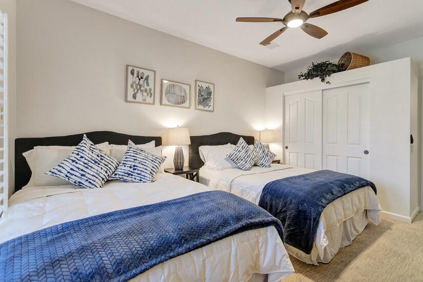 Bedroom 3: Two Queen Beds, Dresser, Smart TV