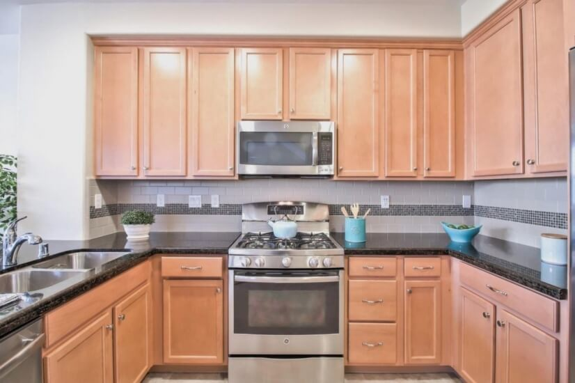 Lot's of cabinets and end-to-end back splash