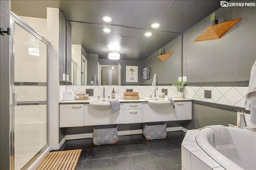 Spacious Master Bathroom with monochromatic designs