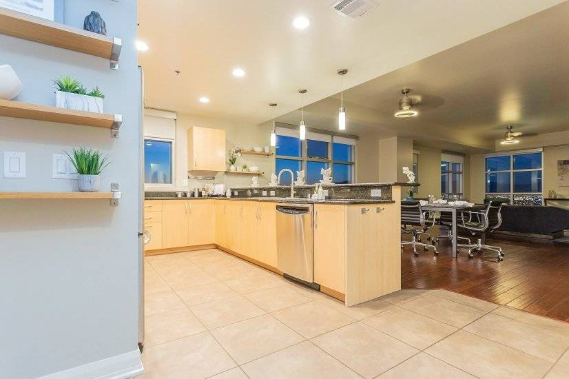 Sleek kitchen with lots of cabinets & counter space