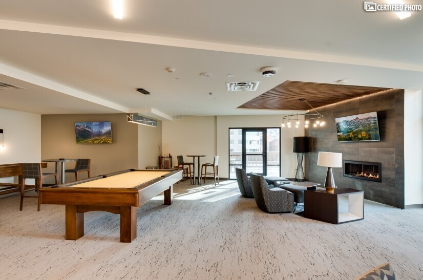 Common lounge area with game tables & multipl