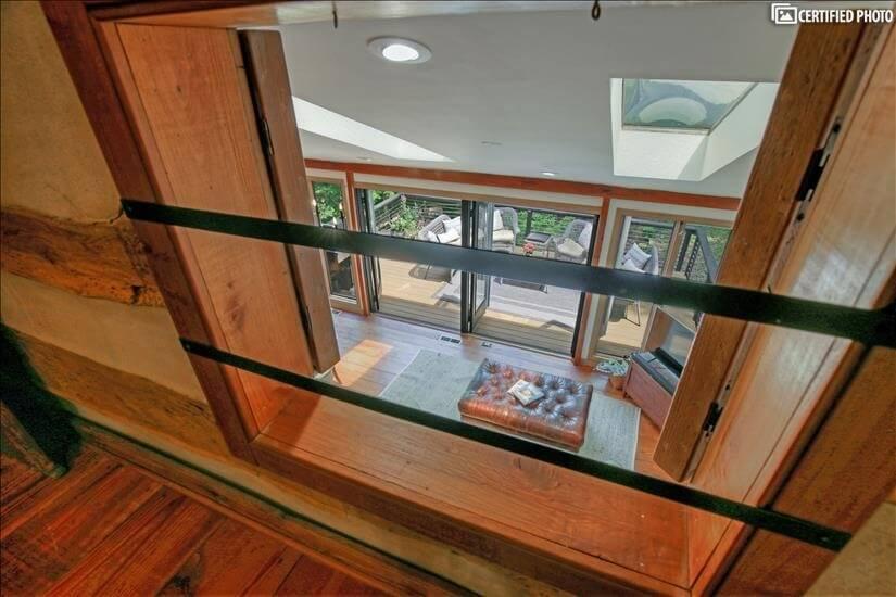 Hayloft windows to the downstairs kitchen/sea