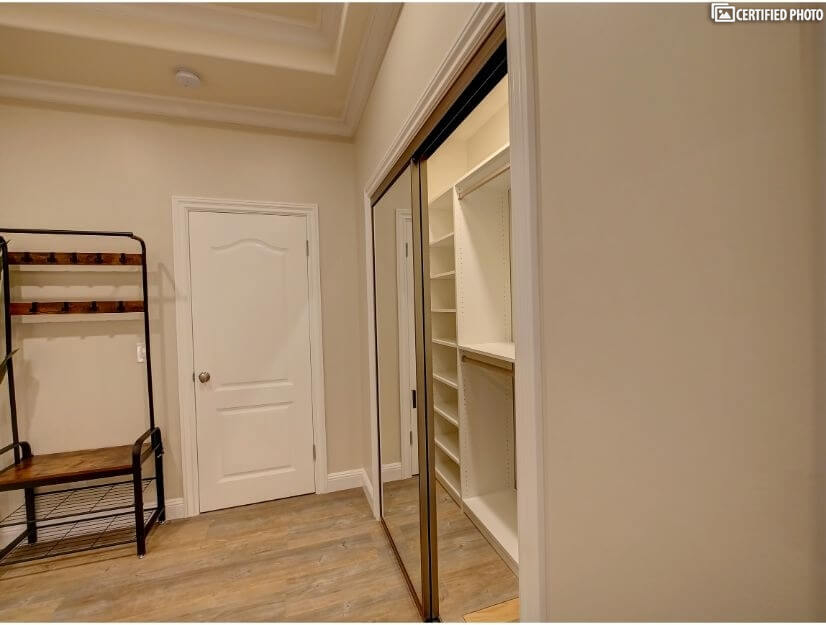 Suite D - Extra-large closet with built in organizers.