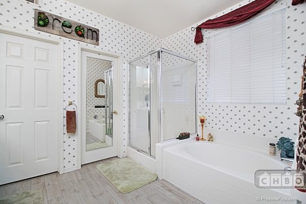 Master Bathroom with separate shower and tub.
