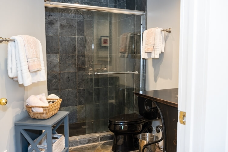 Slate shower in bathroom